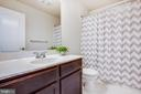 Upper level hall bath has Birch vanity Marble Top. - 4515 POTOMAC HIGHLANDS CIR #133, TRIANGLE