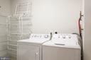 Spacious laundry room with storage - 19355 CYPRESS RIDGE TER #220, LEESBURG