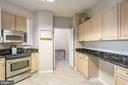 Kitchen with space for small table - 19355 CYPRESS RIDGE TER #220, LEESBURG