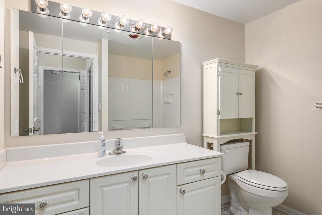 Master Bath with updated tile - 19355 CYPRESS RIDGE TER #220, LEESBURG