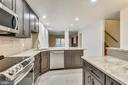 Lots of granite counter space & tile backsplash - 2014 SWANS NECK WAY, RESTON