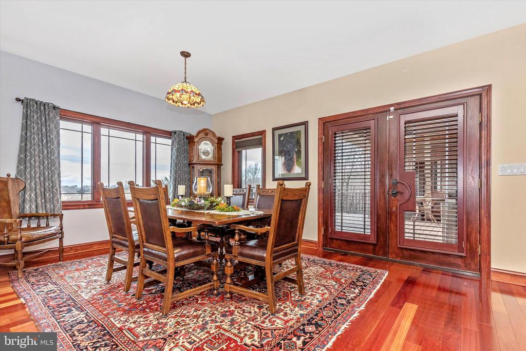 Dining area off kitchen with doors to the deck - 7235 WOODVILLE RD, MOUNT AIRY