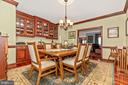 Separate dining room  with handmade maple cabinets - 7235 WOODVILLE RD, MOUNT AIRY
