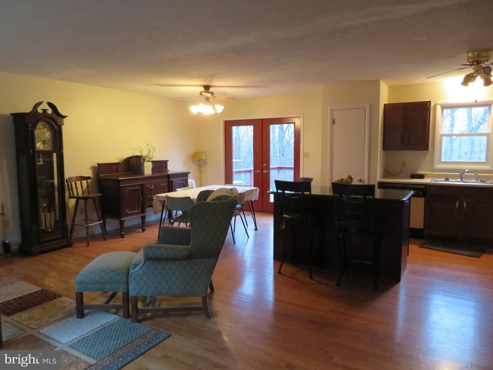 Living room into dining room and kitchen!