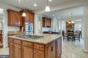 Open Concept Kitchen with Large Island - 21431 FAIRHUNT DR, ASHBURN