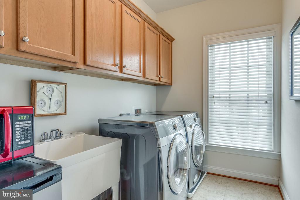 Upstairs Laundry with Front Load Washer & Dryer - 21431 FAIRHUNT DR, ASHBURN