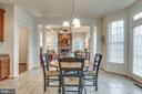 Eat-In Kitchen leads to family room - 21431 FAIRHUNT DR, ASHBURN