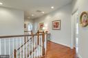 Upstairs Hallway features Hardwoods to 5 Bedrooms - 21431 FAIRHUNT DR, ASHBURN