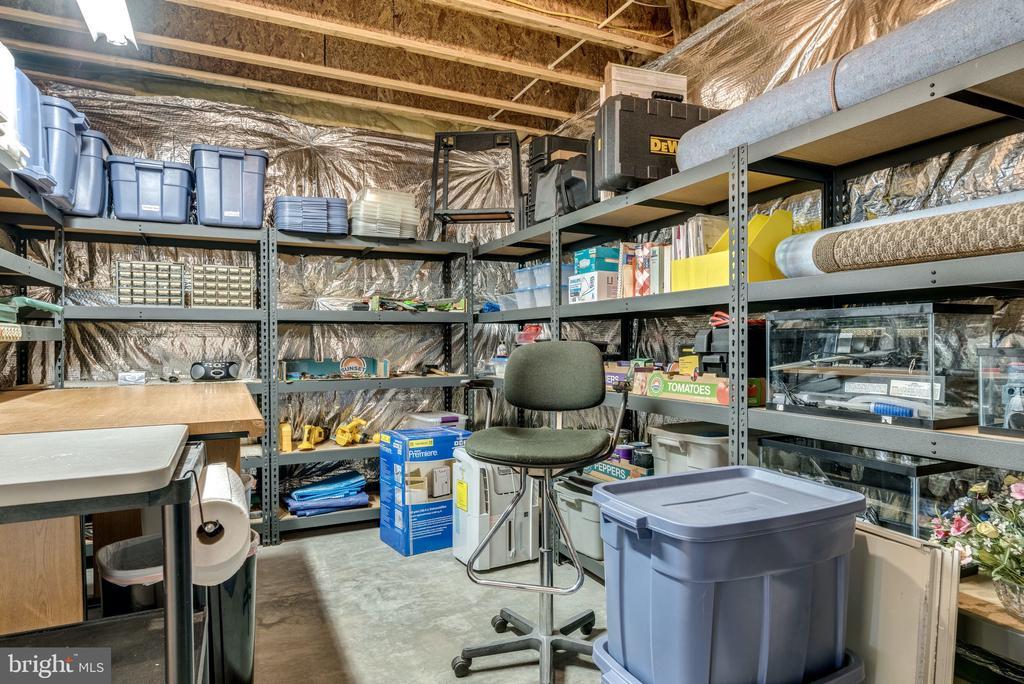 Storage & Workshop area in Basement - 21431 FAIRHUNT DR, ASHBURN
