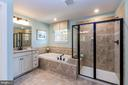 Master bath's upgraded tile & oiled bronze accents - 14311 BENTLEY PARK DR, BURTONSVILLE