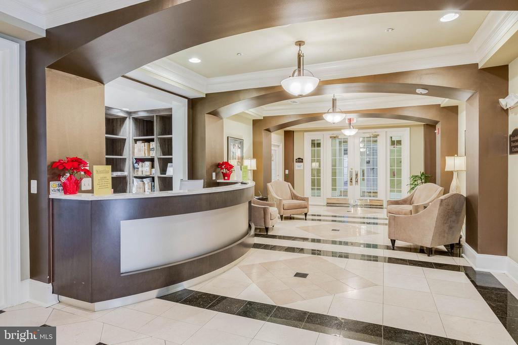 Concierge desk in the community center - 11750 OLD GEORGETOWN RD #2430, NORTH BETHESDA