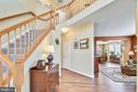 Two story Foyer.  Engineered wood on main level - 1301 FEATHERSTONE LN NE, LEESBURG