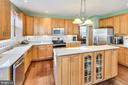 Spacious kitchen w/ lots of counter space - 1301 FEATHERSTONE LN NE, LEESBURG