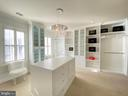 Master bedroom Chanel inspired boutique closet - 18184 SHINNIECOCK HILLS PL, LEESBURG