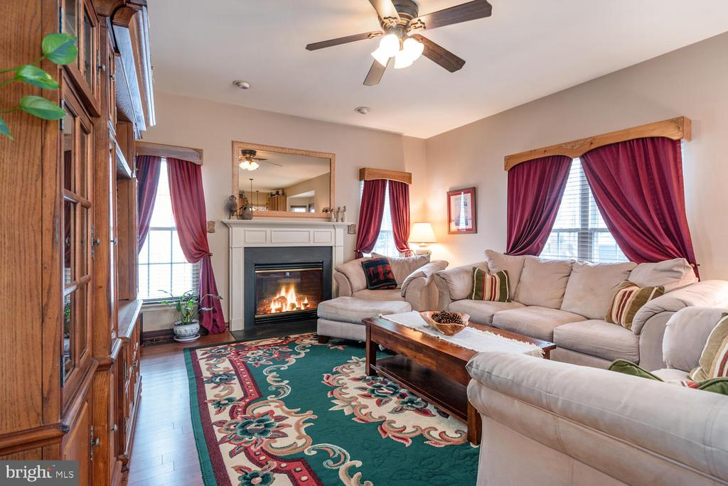 Family Room off kitchen with gas fireplace. - 8 STONERIDGE CT, STAFFORD