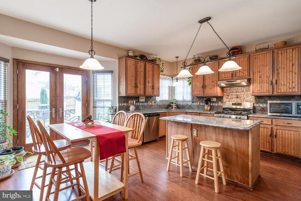 Eat-in Area with Pella French Doors to deck - 8 STONERIDGE CT, STAFFORD