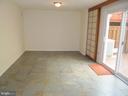 Lower Level Family room with Porcelain Floor - 8396 UXBRIDGE CT, SPRINGFIELD