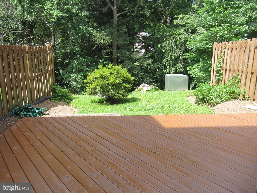 Deck off lower level Family Room in Summer - 8396 UXBRIDGE CT, SPRINGFIELD