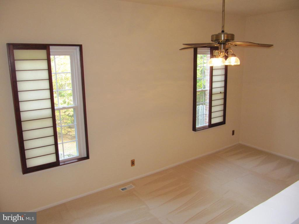 View of Unfurnished Living Room From Dining Room - 8396 UXBRIDGE CT, SPRINGFIELD