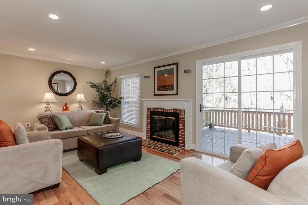 Living room :wood burning FP, french drs to deck - 2522 S WALTER REED DR #4, ARLINGTON