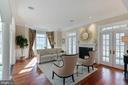 Living Room with gas fireplace & covered balcony - 8033 WOODLAND HILLS LN, FAIRFAX STATION