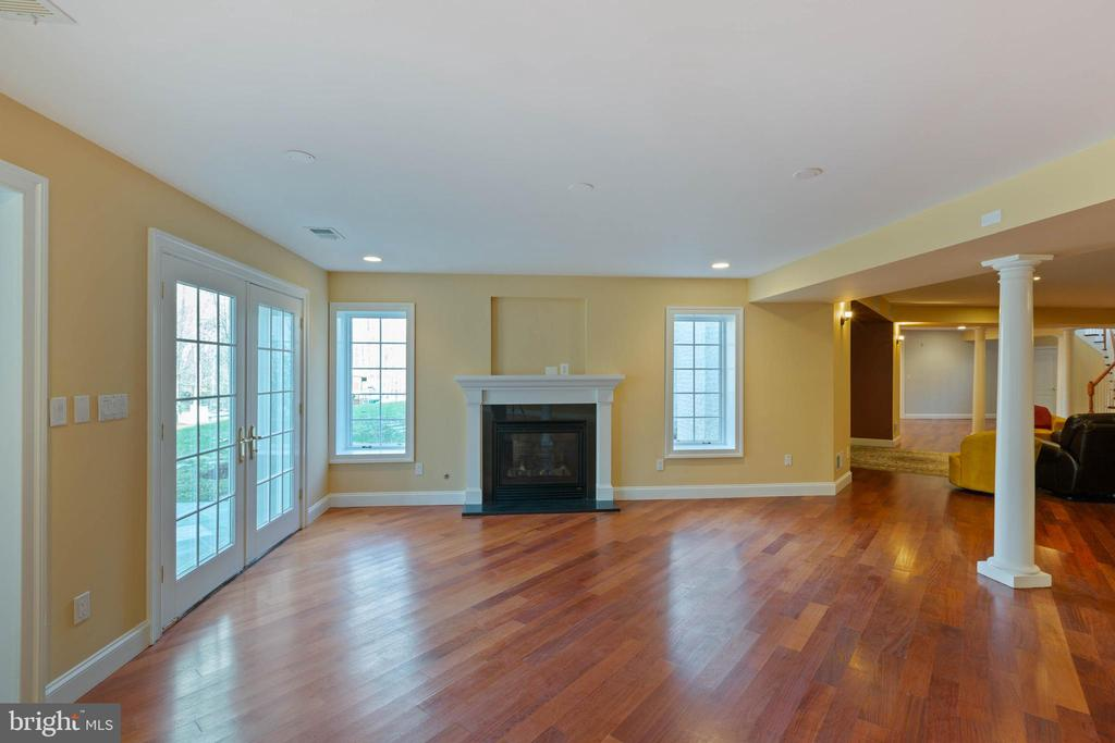 Lower Level - Recreation Area with Gas Fireplace - 8033 WOODLAND HILLS LN, FAIRFAX STATION
