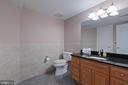 Lower Level - Half Bath by back staircase/elevator - 8033 WOODLAND HILLS LN, FAIRFAX STATION