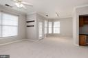 Living room and dining room are loaded with light - 12112 GARDEN GROVE CIR #401, FAIRFAX