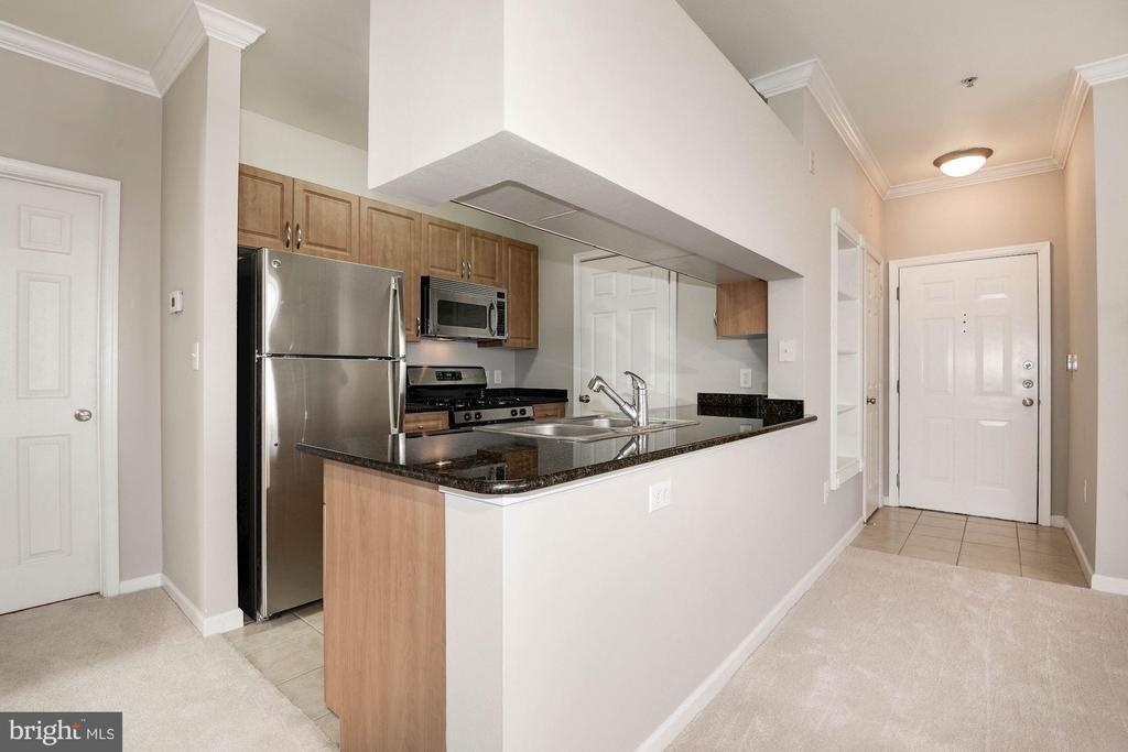 Kitchen with stainless steel appliances - 12112 GARDEN GROVE CIR #401, FAIRFAX