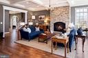 Family room with stone fireplace - 18293 WILD RASPBERRY DR, PURCELLVILLE