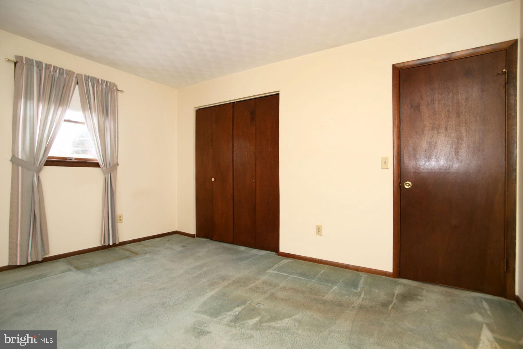 Bedroom 2 with double door closet