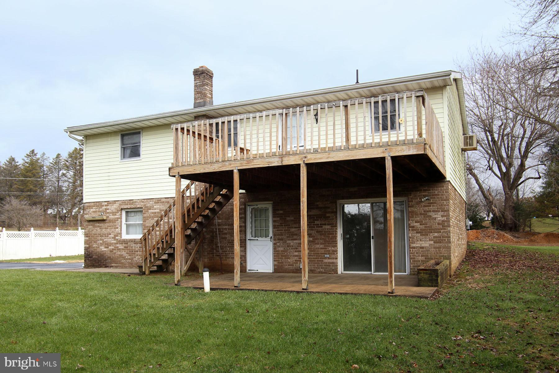 Exposed Lower Level with deck and patio
