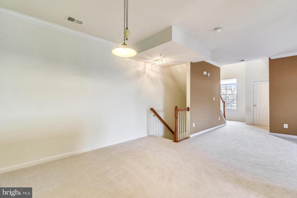 View fr dining rm to entrance & hallwy to upstairs - 43415 MADISON RENEE TER #117, ASHBURN