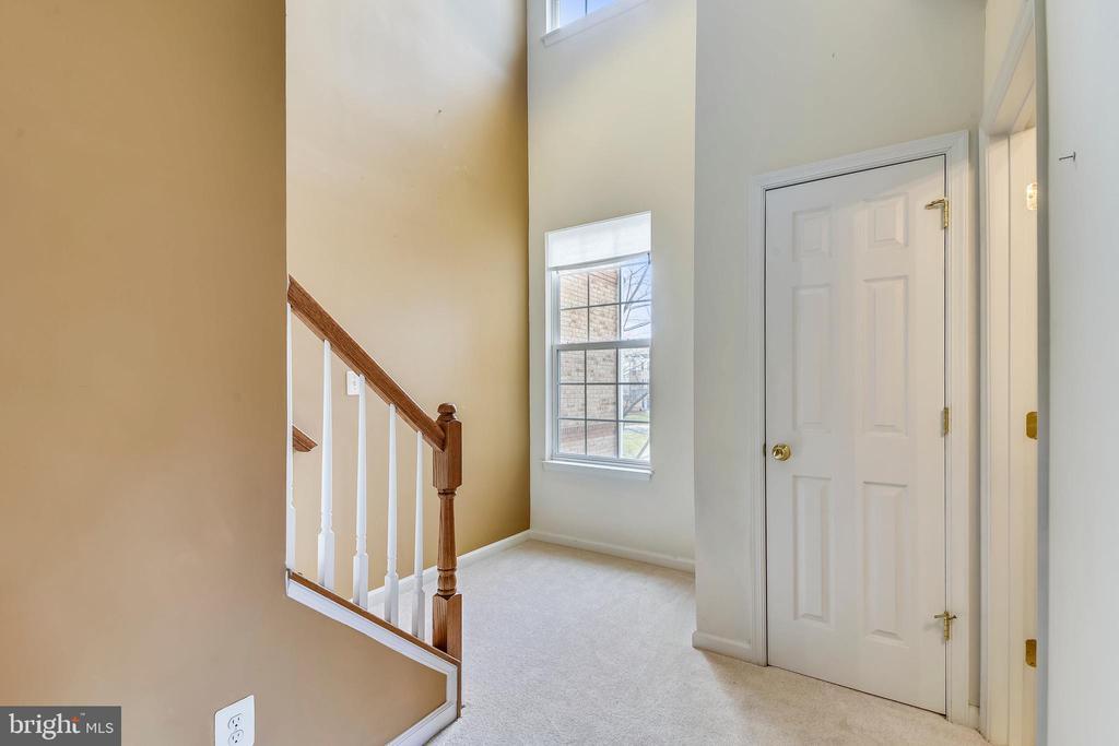 Powder room, coat closet & stairs to upper level - 43415 MADISON RENEE TER #117, ASHBURN