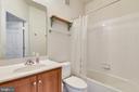 Hall bath w/maple vanity & tub w/tile surround - 43415 MADISON RENEE TER #117, ASHBURN