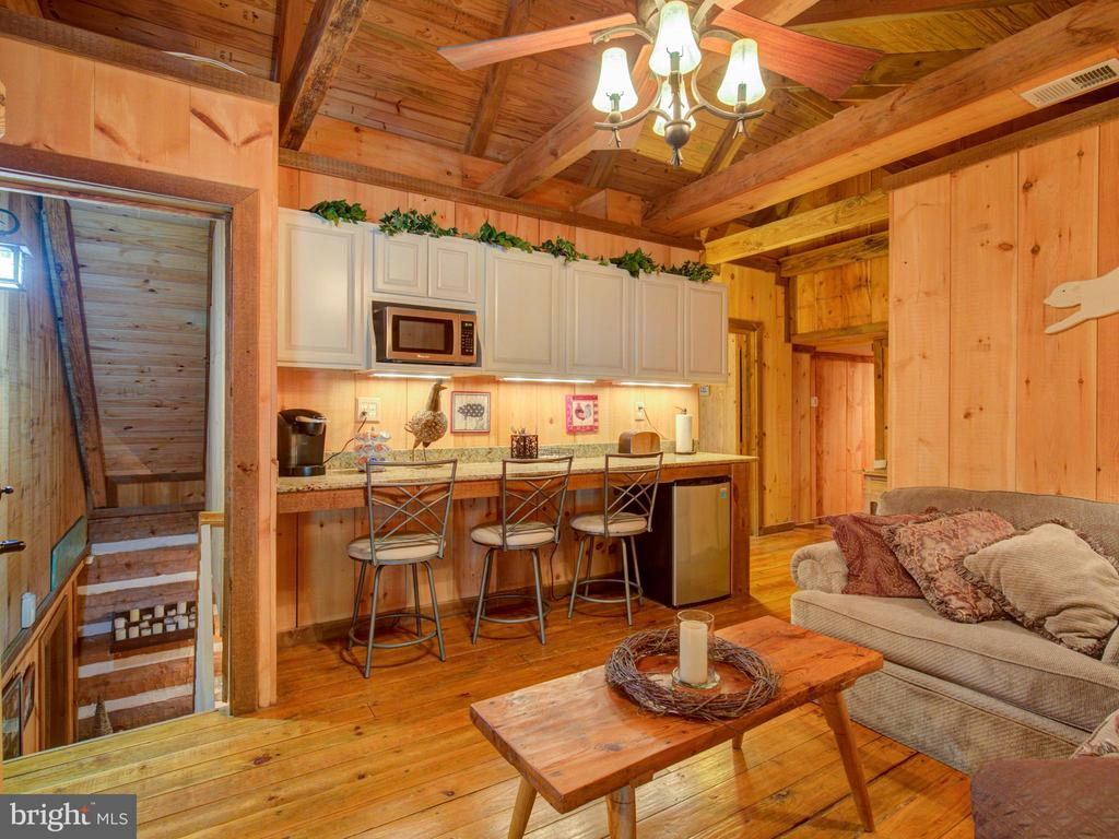 Upper level family room with bar area and fridge - 36847 STONY POINT RD, HILLSBORO