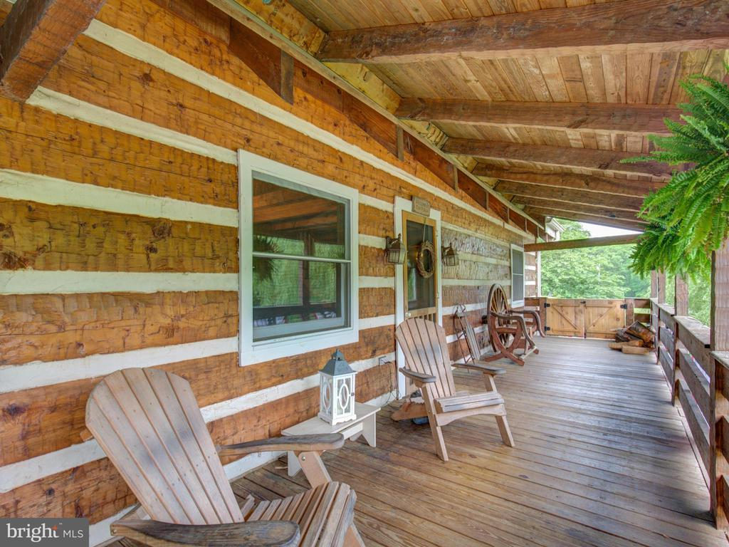 Large front porch to enjoy a shady spot and views - 36847 STONY POINT RD, HILLSBORO