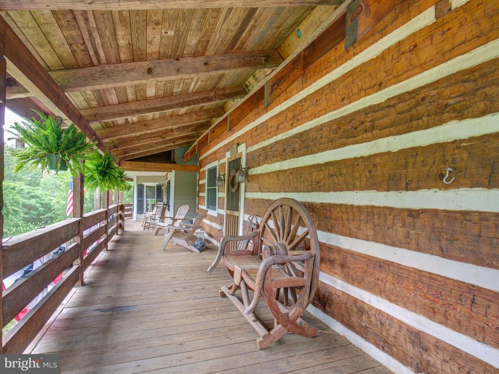 Front porch showing off the wood exterior - 36847 STONY POINT RD, HILLSBORO