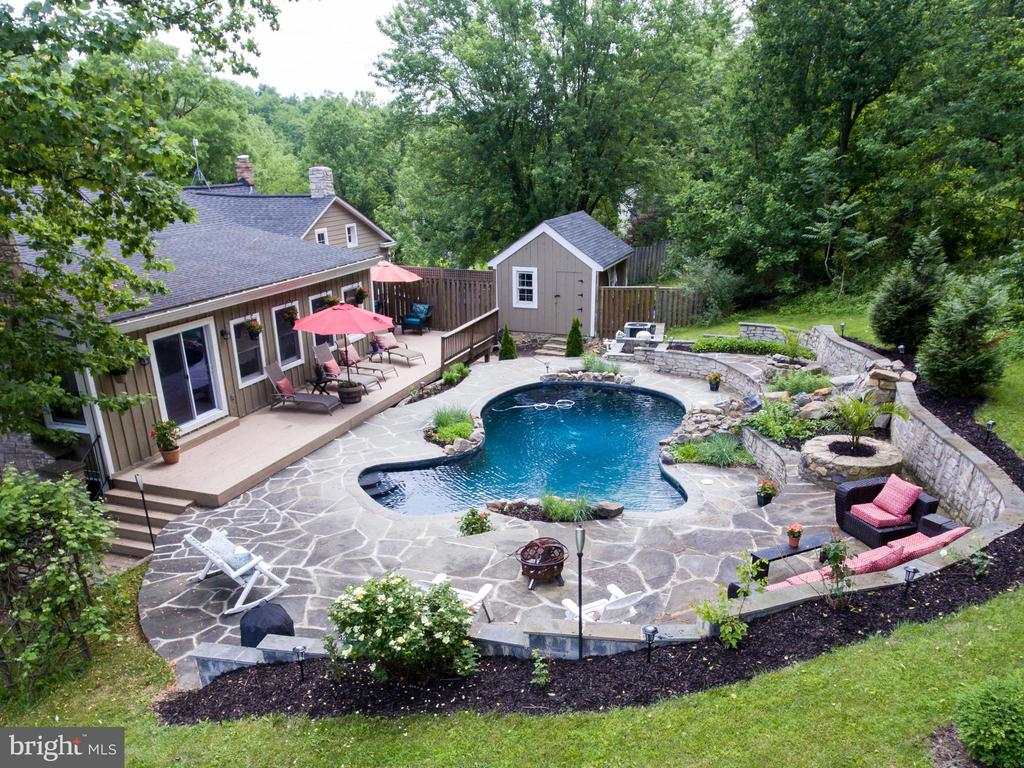 Aerial view of the pool and rear of house - 36847 STONY POINT RD, HILLSBORO