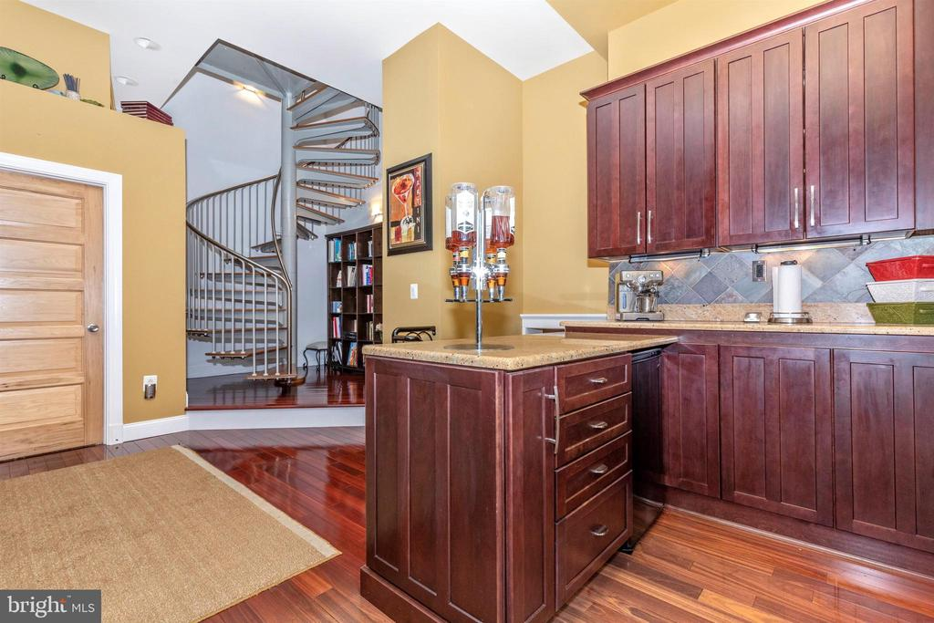 Spiral staircase leads to loft - 2180 S CRISSFORD RD, ADAMSTOWN