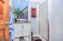Bathroom located off of main level bedroom - 2180 S CRISSFORD RD, ADAMSTOWN
