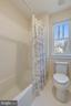 Shower area in Buddy/Hall Bath - 315 BONHEUR AVE, GAMBRILLS