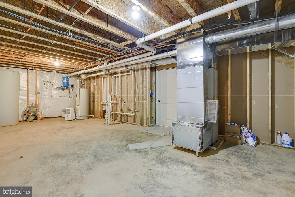 Unfinished storage and mechanical area - 299 BONHEUR AVE, GAMBRILLS