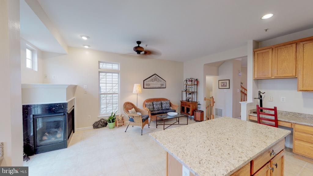 Kitchen with sitting area and fireplace - 416 PHELPS ST, GAITHERSBURG