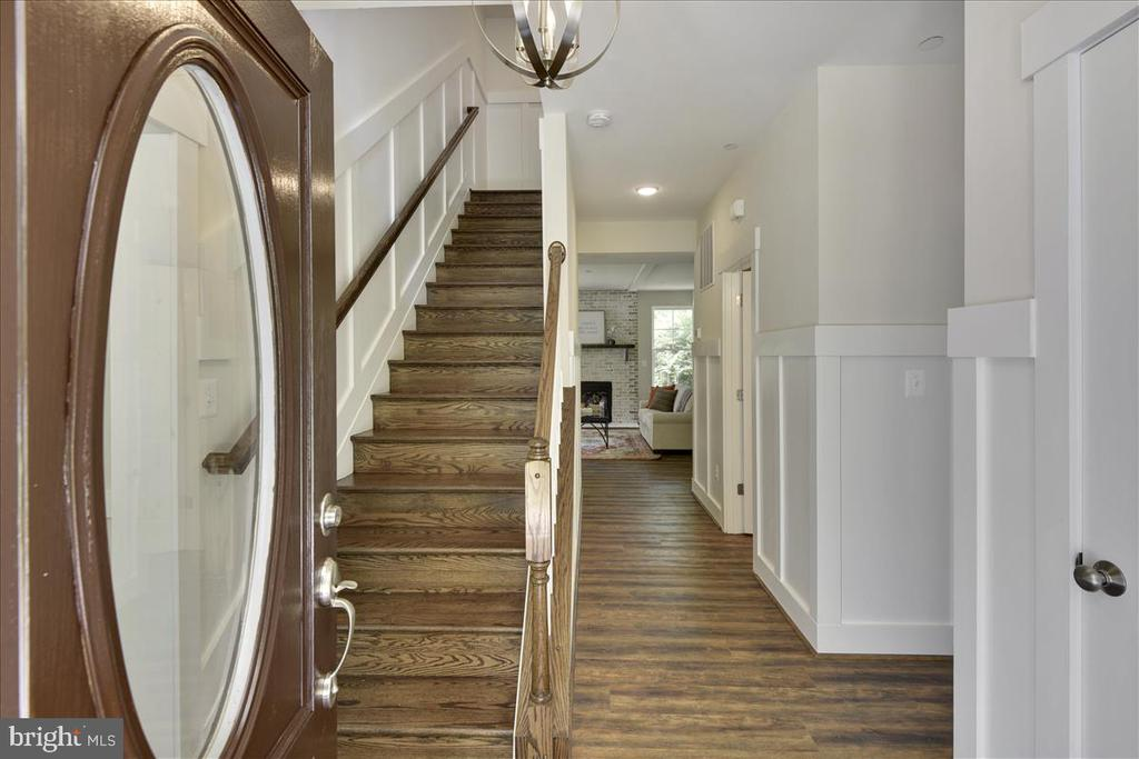 Foyer showing upgraded wood staircase and moldings - 1512 BEAUX LN, GAMBRILLS