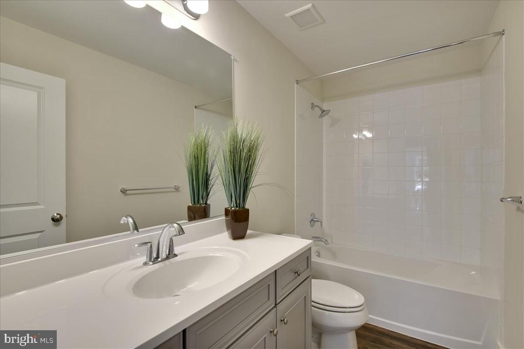 Representative Hall Bathroom with upgraded floors - 1512 BEAUX LN, GAMBRILLS