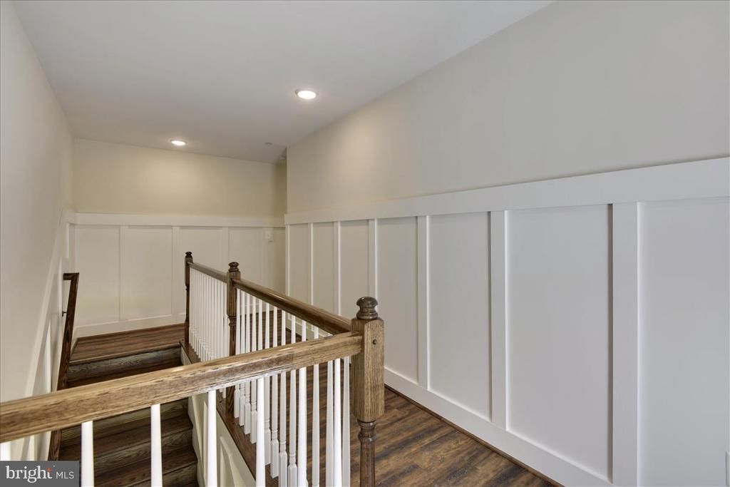 Hallway showing upgraded floors and moldings - 1512 BEAUX LN, GAMBRILLS