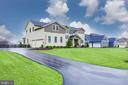 Extended driveway accommodates many cars - 22982 HOMESTEAD LANDING CT, ASHBURN