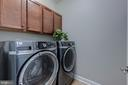 Laundry room on upper level with cabinets - 22982 HOMESTEAD LANDING CT, ASHBURN