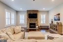 Gorgeous stacked stone fireplace - 22982 HOMESTEAD LANDING CT, ASHBURN